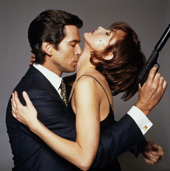 Irish actor Pierce Brosnan as James Bond, with his 'GoldenEye' co-star Izabella Scorupco, circa 1995. (Photo by Terry O'Neill/Getty Images)